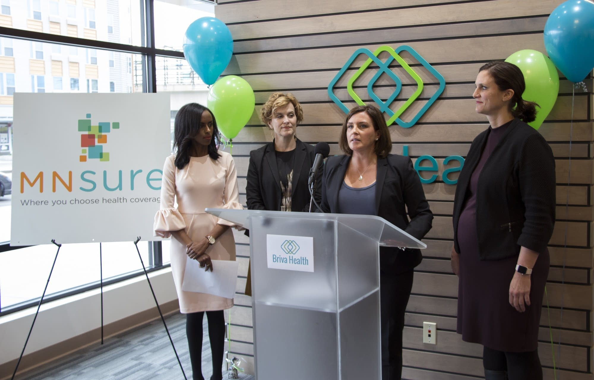 MNsure CEO Allison O'Toole speaks at an open enrollment launch event.