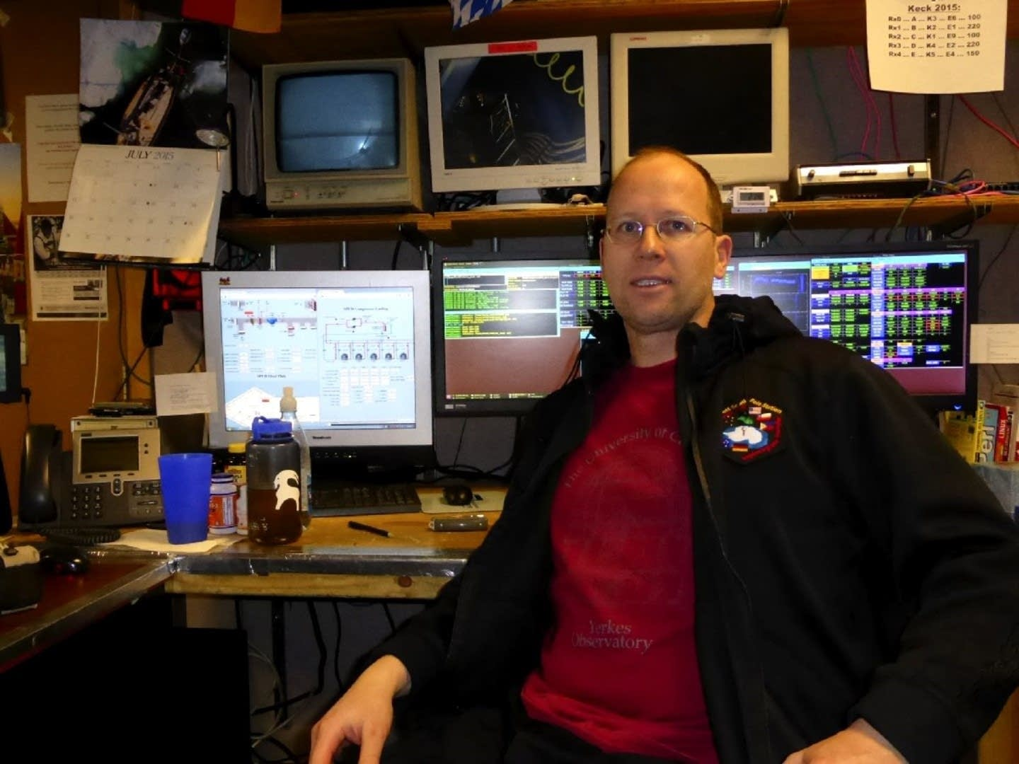Robert Schwarz sits in front of the controls to the Keck Array.