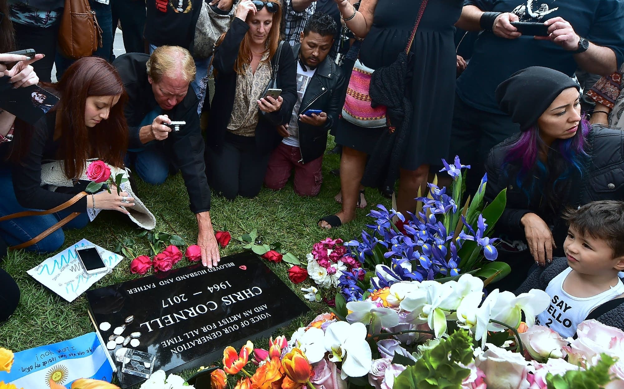 Fans visit the grave of Chris Cornell at Hollywood Forever Cemetery.