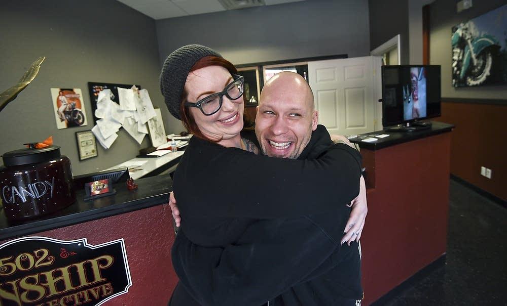 Friend Amy Williams hugs Michael Hansen.