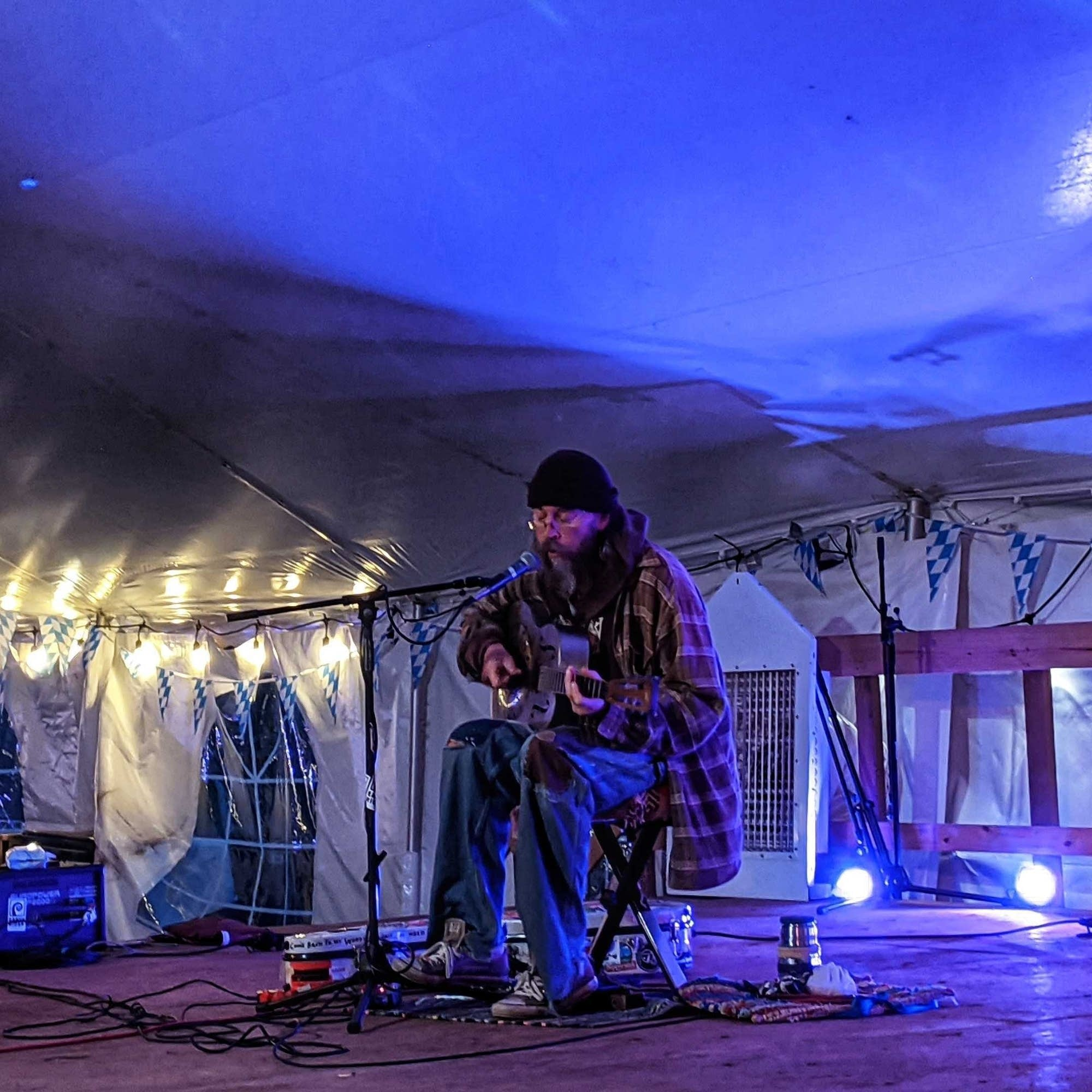 Charlie Parr performs in the Cedar Lounge tent, 2020.