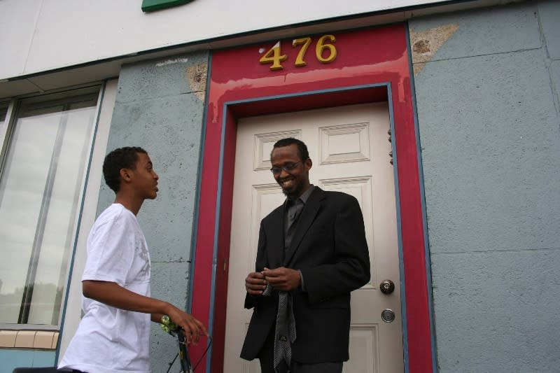 Sharif talks with a boy near the mosque