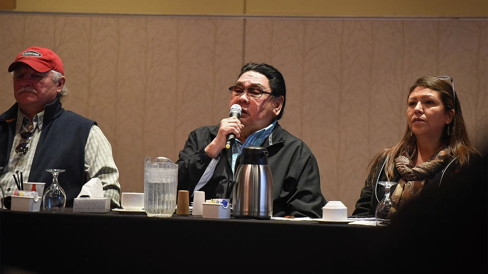Red Lake Tribal Chairman Darrell Seki, center, opens a meeting.