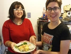 Writer Soleil Ho, graphic artist Blue Delliquanti with a bee larvae omelet