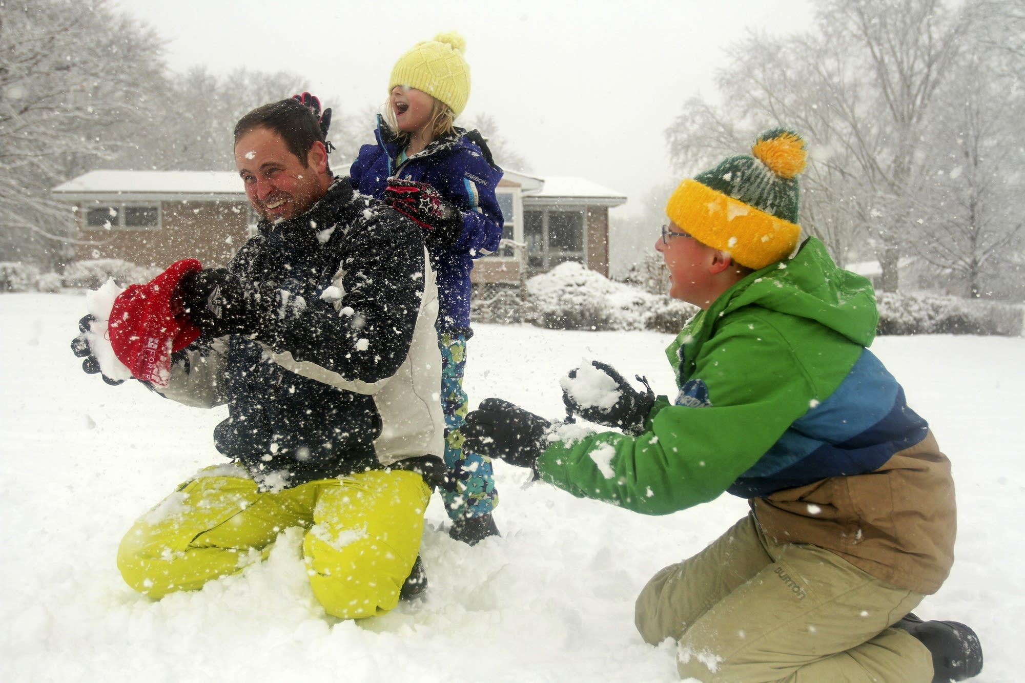 Mark Westerman had a snowball fight with his children, Kayla and Andrew.