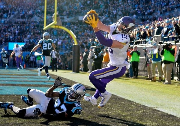 Adam Thielen attempts a catch against the Panthers Kevon Seymour.