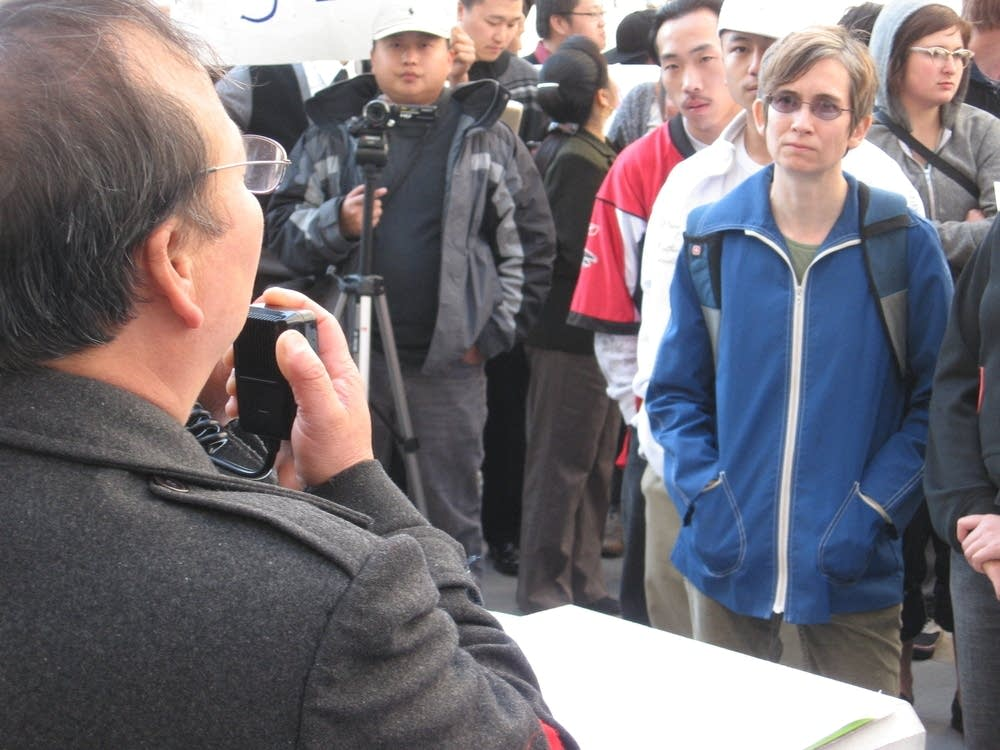 Yia Lee speaks to protestors