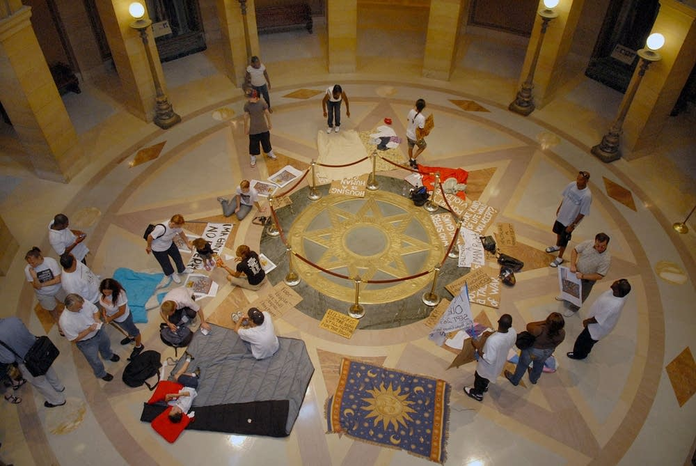 A human rights group protests at the State Capitol