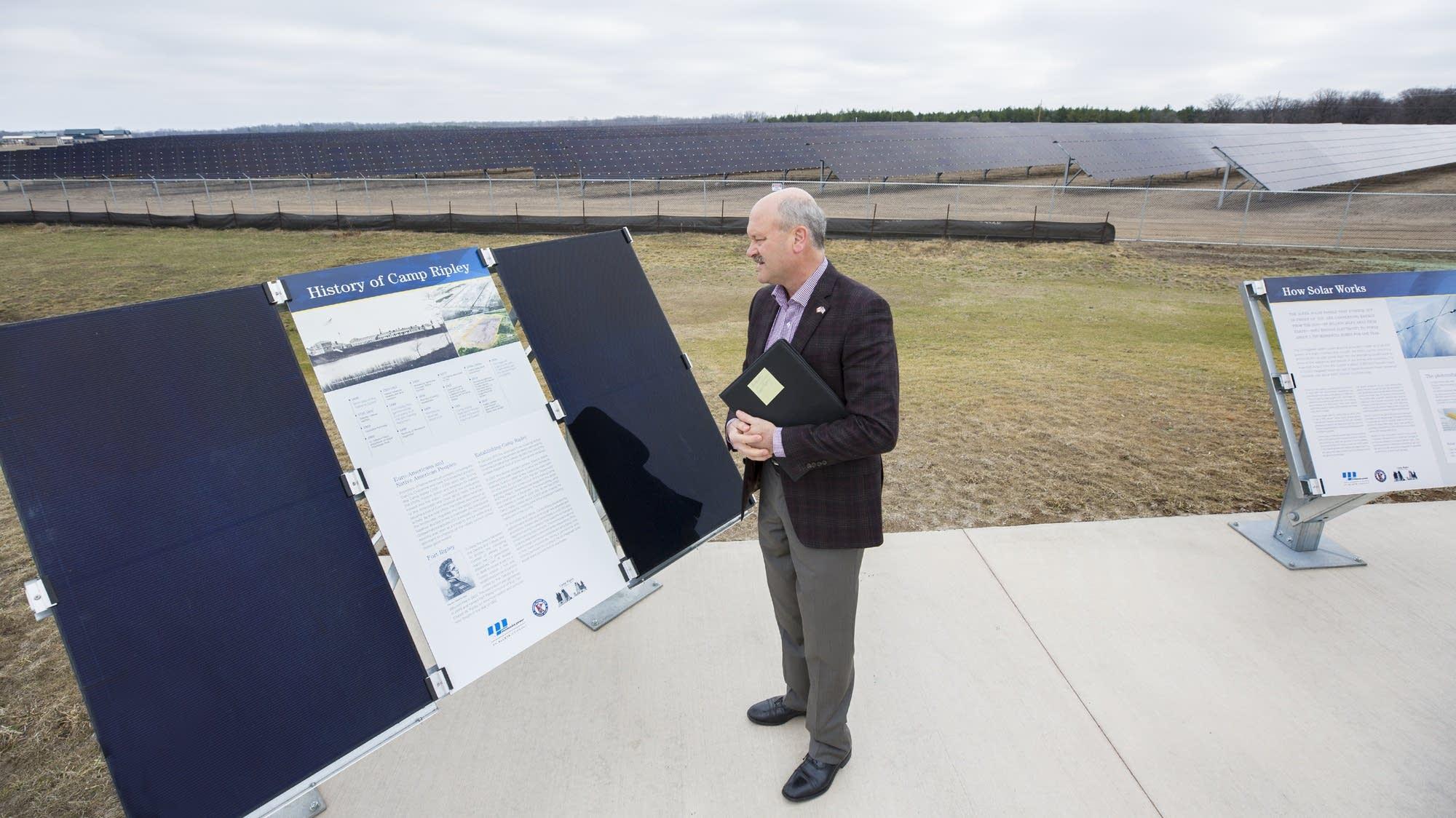 Al Hodnik visits a solar panel dislplay