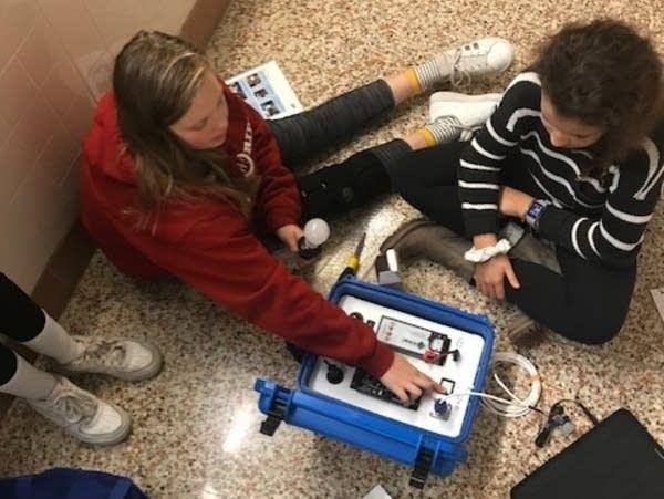 Students at St. Louis Park Middle School assemble a solar suitcase.