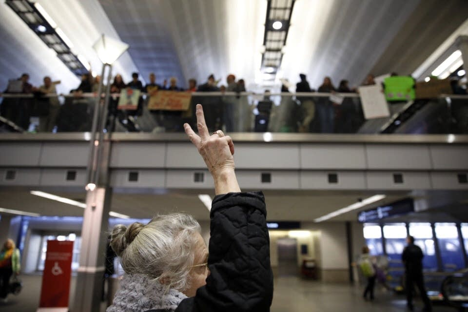 Travelers show signs of support for the protesters during a rally.