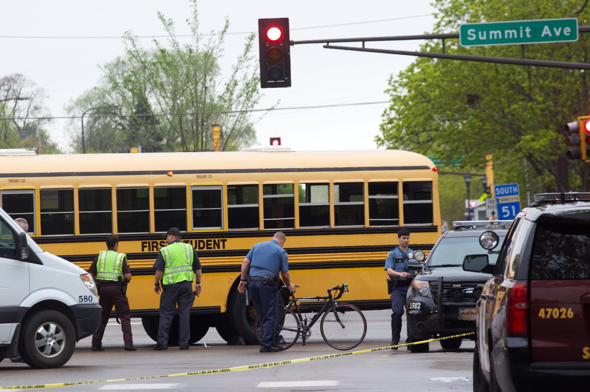 St. Paul police remove the bike of a man killed in a collision with a bus.