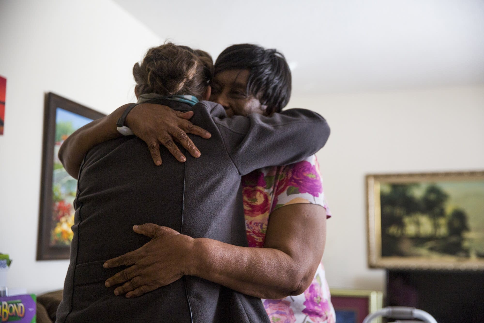 Rosalyn Cole hugs Judy Jones after receiving her Meals on Wheels delivery.