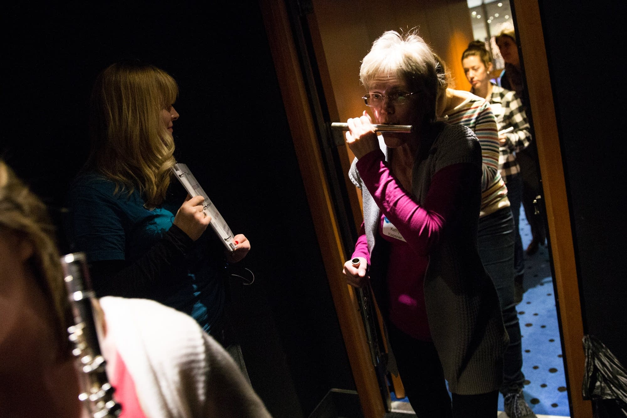 Flutists enter the Ordway floor.