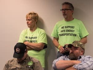 Line three supporters wait for the hearing to begin.