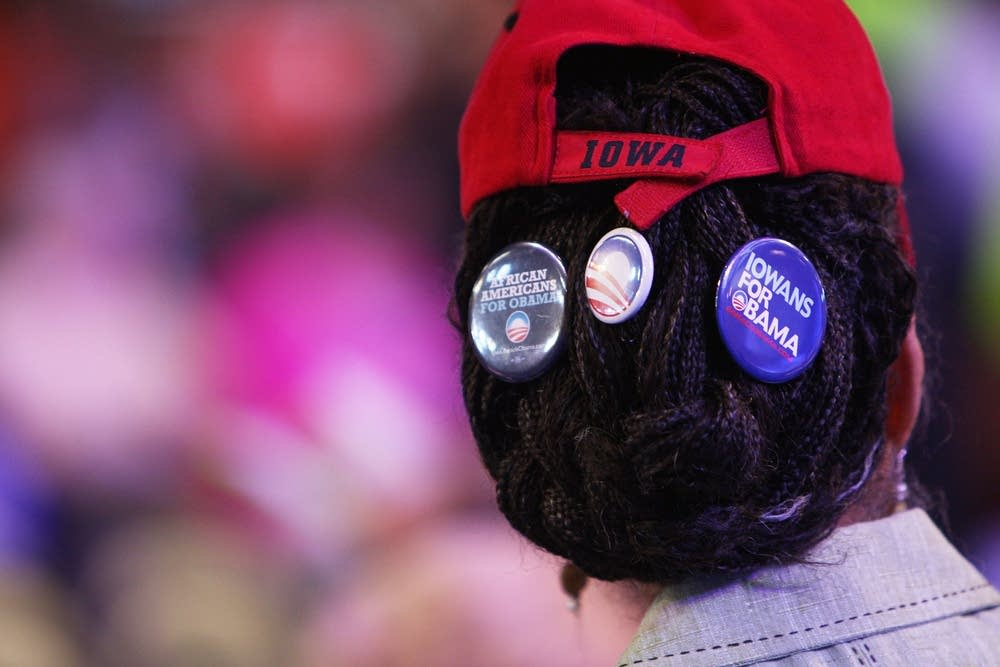 An Obama supporter wears buttons at the DNC