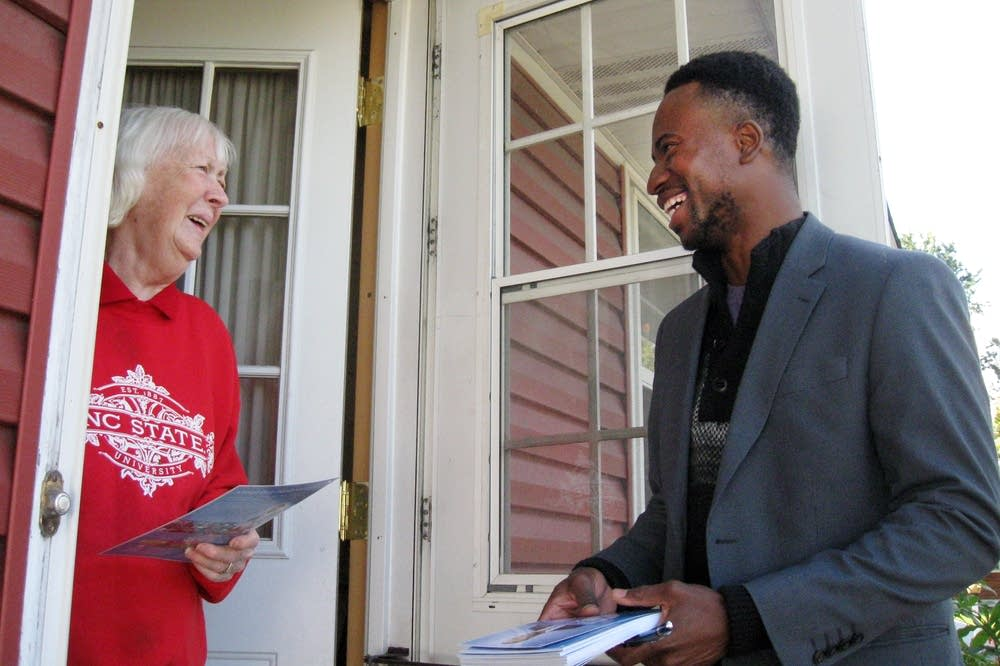 Mike Elliott talks with voter Nancy Tanji.