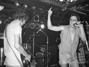 Paul Westerberg and Bill Sullivan on stage.