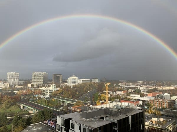 Photo of a huge rainbow over the city of Portland, OR