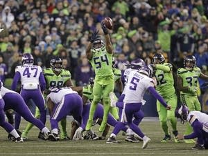 Seattle Seahawks' Bobby Wagner (54) leaps to block a field goal attempt.