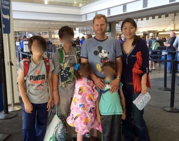 James Cook and Hitomi Arimitsu with their children.