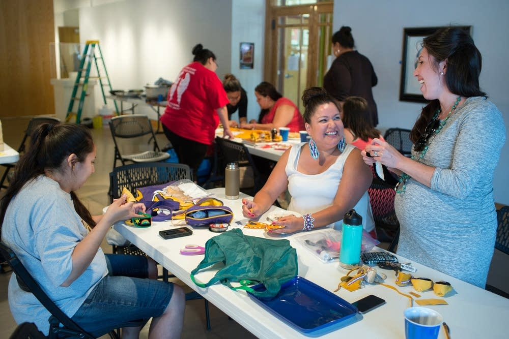 Volunteers make baby moccasins