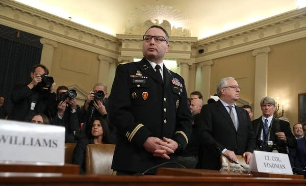 A military official prepares to testify.