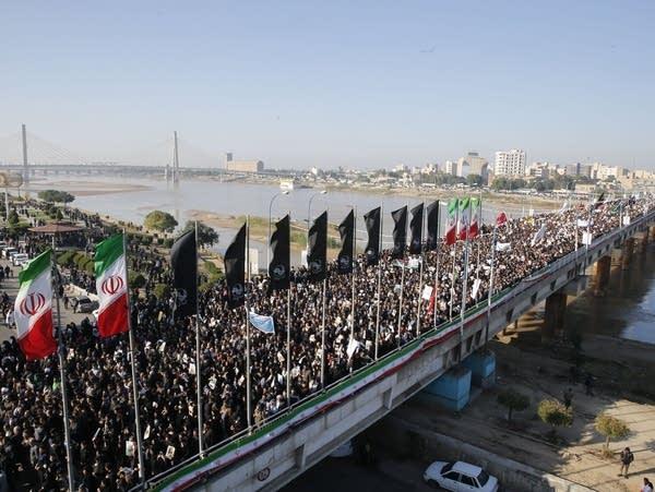 Iranians march on Sunday, Jan. 5, 2020
