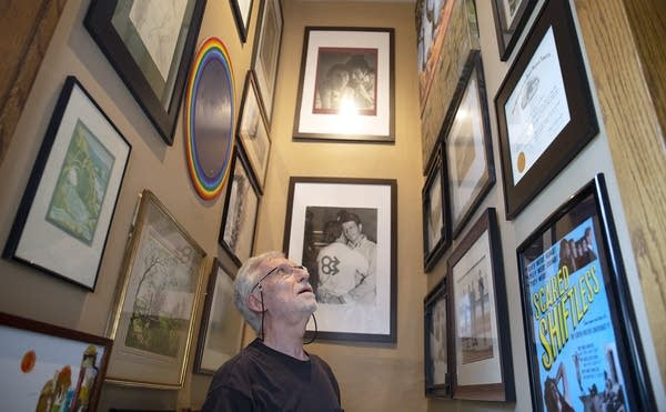 Michael McConnell talks about artwork and photographs in his hall.