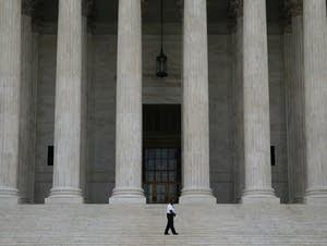 A guard outside the U.S. Supreme Court