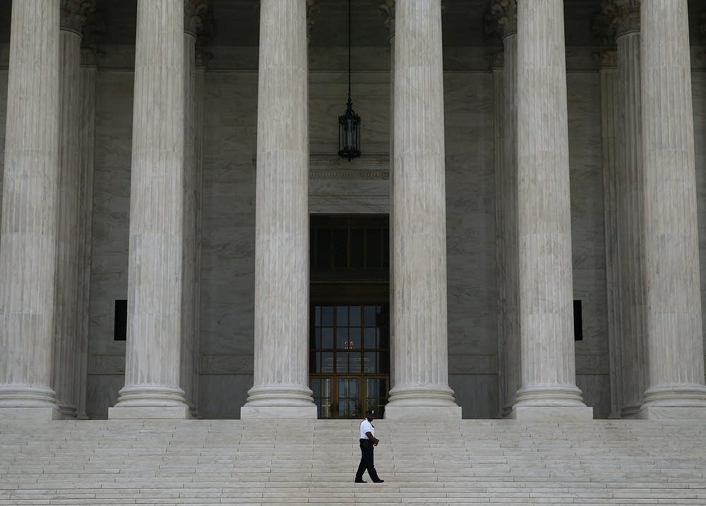 A guard outside the U.S. Supreme Court
