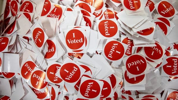 "A pile of red ""I Voted"" stickers."