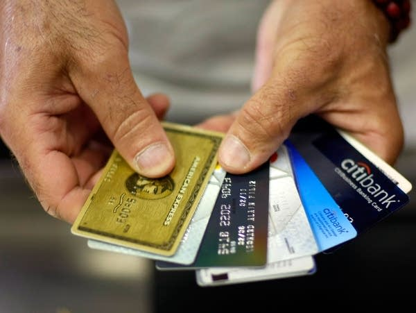 A man holds credit cards