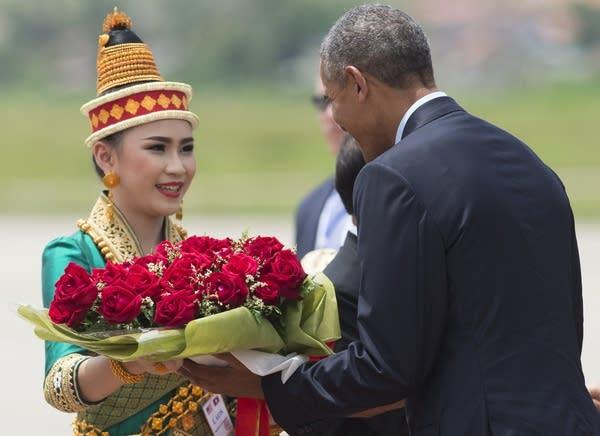 President Obama receives flowers in Luang Prabang.