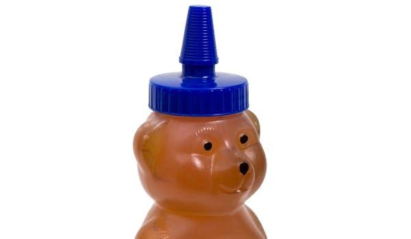 Plastic honey bottle shaped like a bear -- closeup on the face