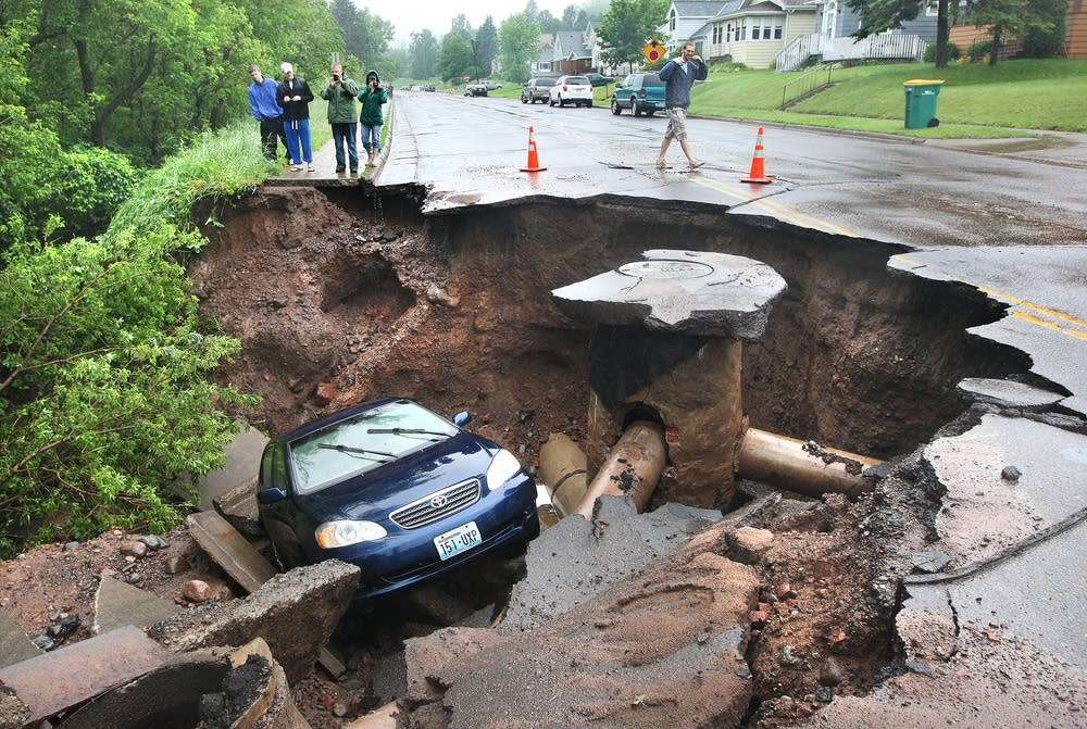 A car fell into a huge sinkhole