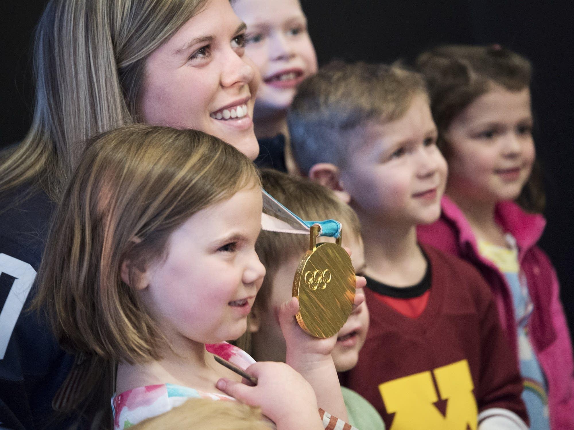 Lucy Werner, 6, left, holds Hannah Brandt's gold medal.