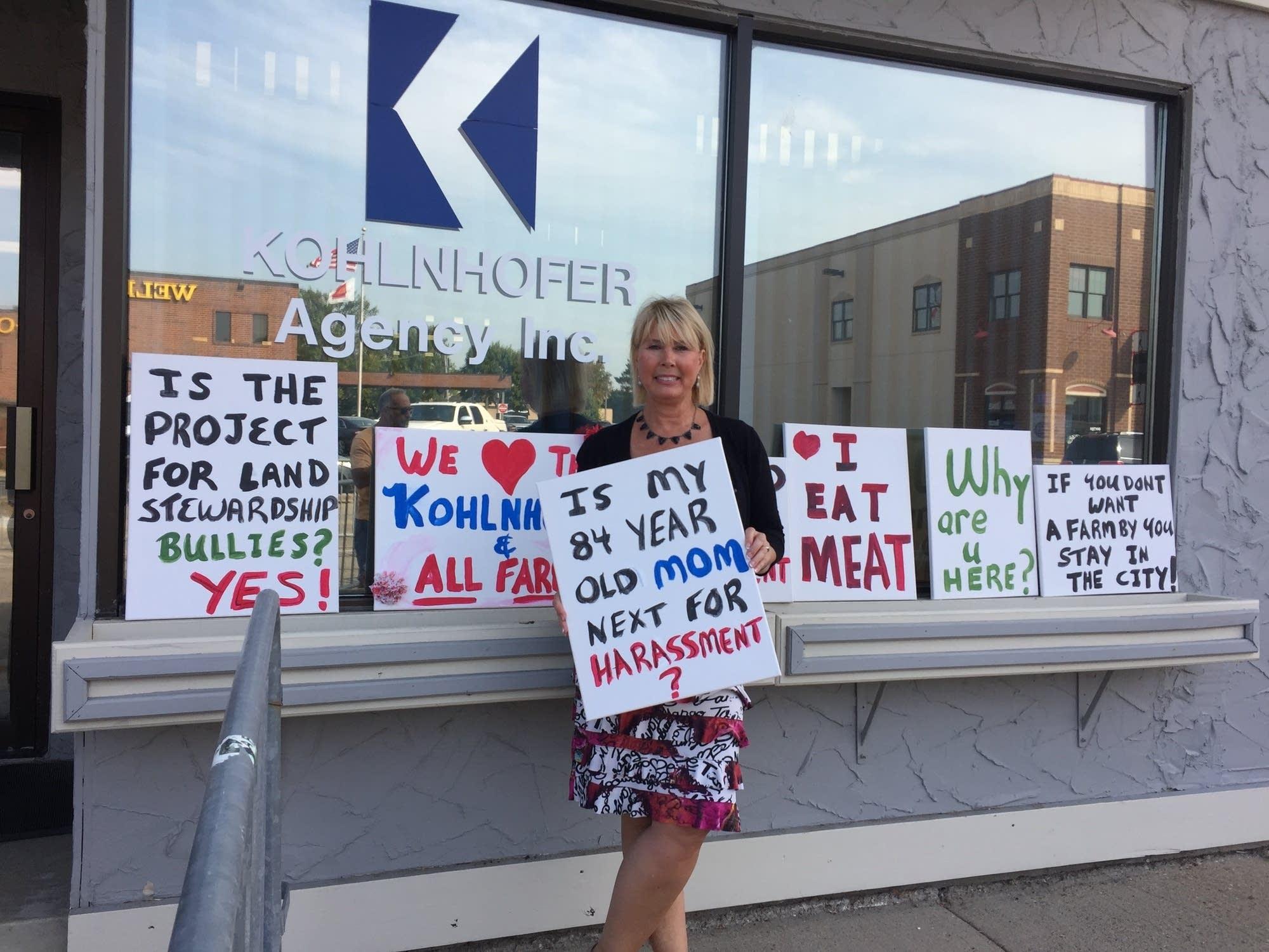 Beth Kohlnhofer Raskovich stands by her insurance agency in Lakeville
