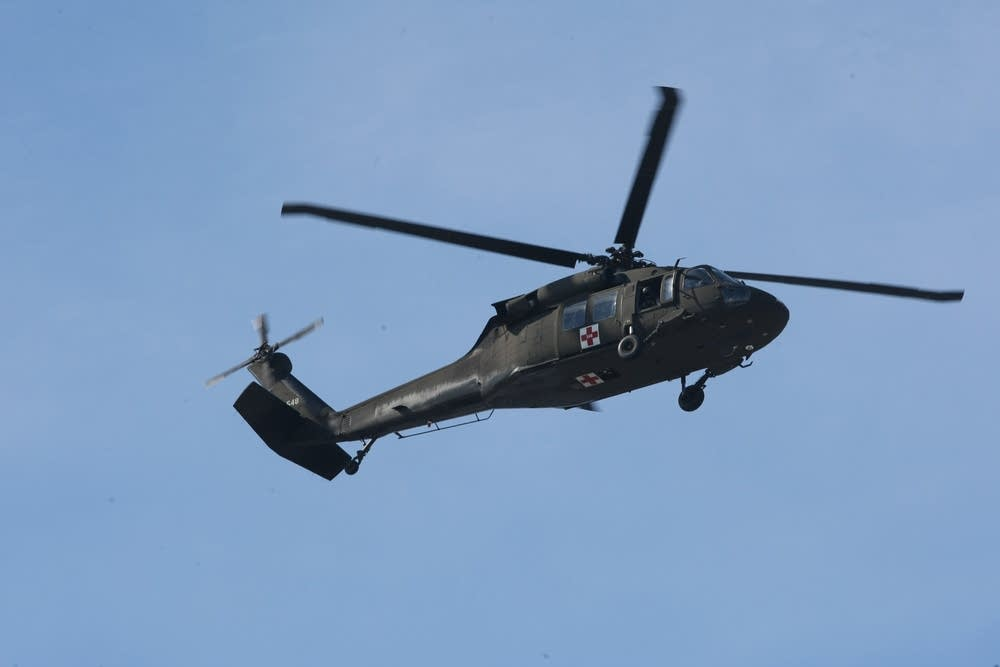 Military helicopter flies over Moorhead