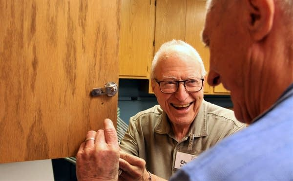 Chuck Claude, 88, of Hopkins holds a new cabinet handle