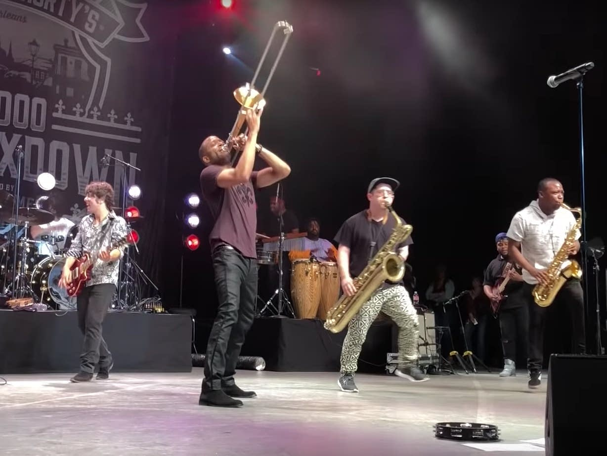 Dave Grohl performs with Trombone Shorty & the Orleans Avenue.
