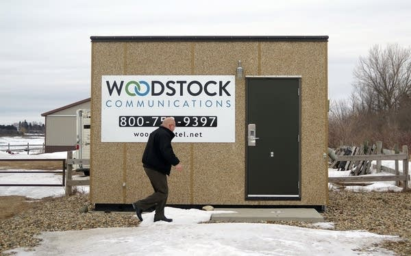 Woodstock Comm. GM Terry Nelson visits a small hut housing broadband gear.
