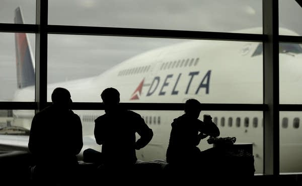 Travelers on Delta Airlines