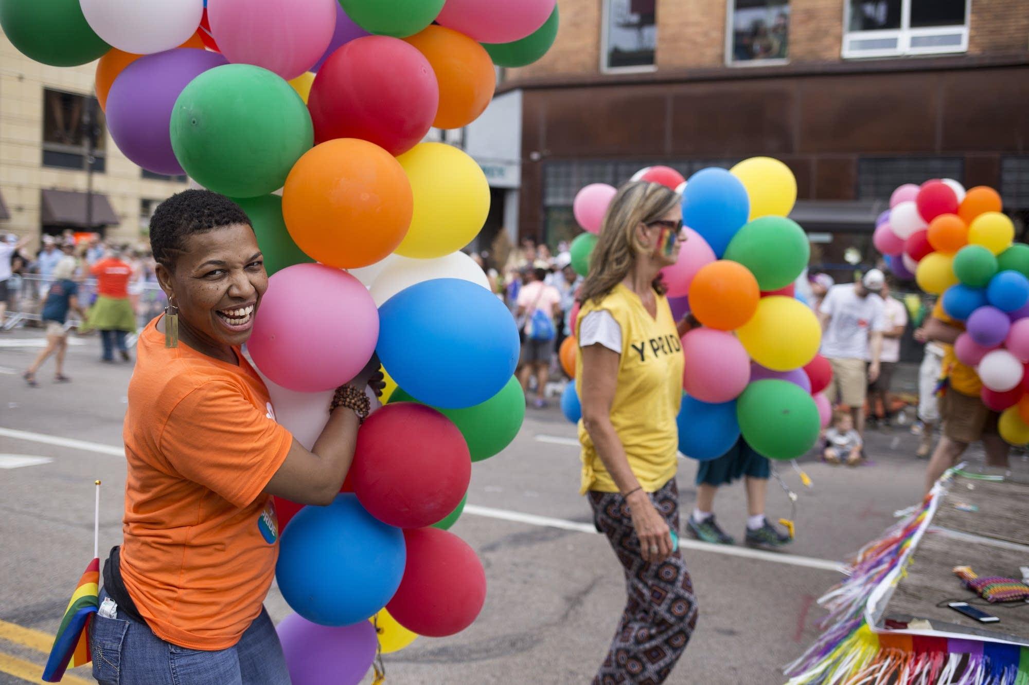 YMCA program director Shun Tucker marches.