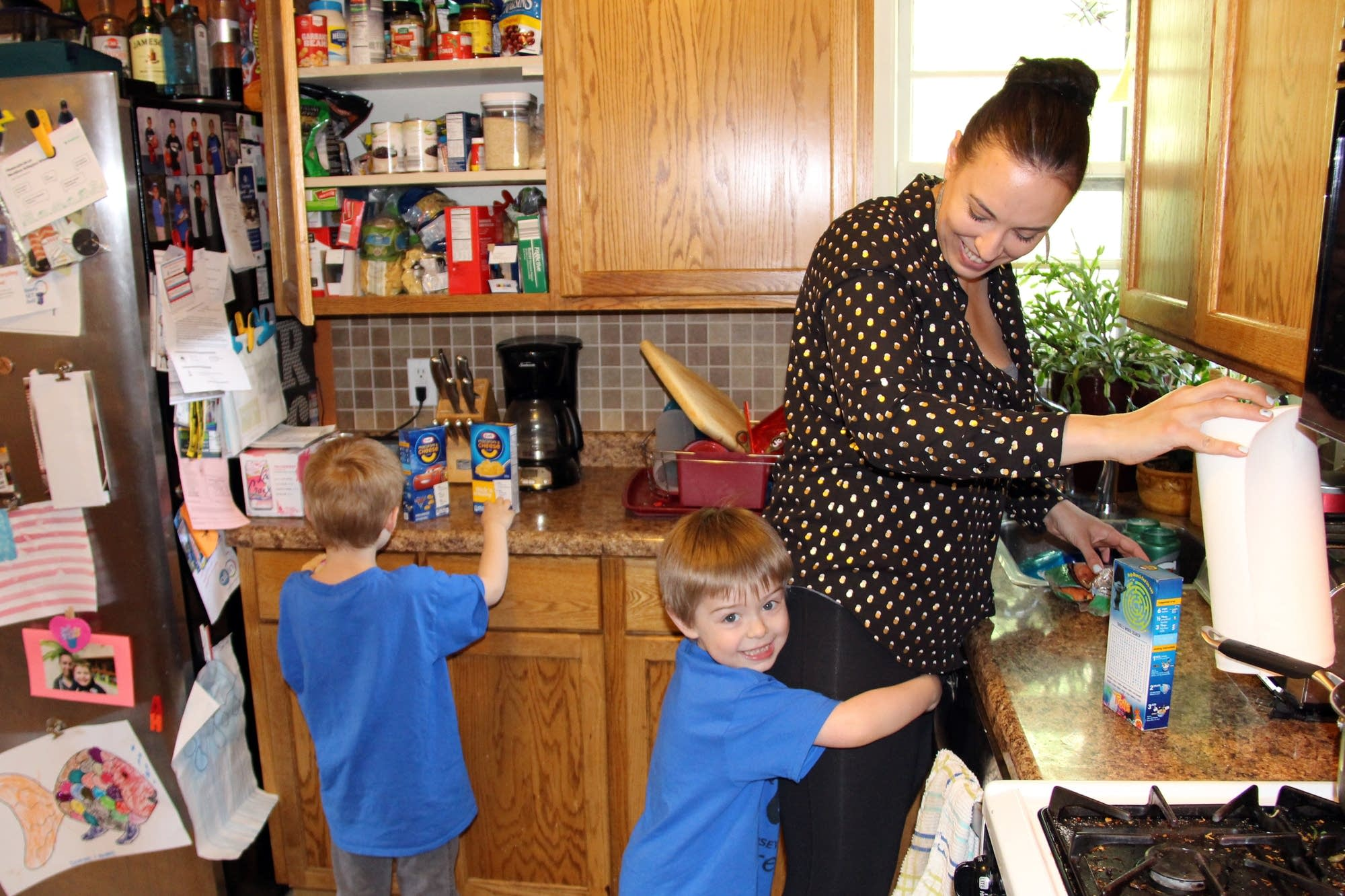 Ruth DeFoster, 32, and her four-year-old twins Dominic and Anthony