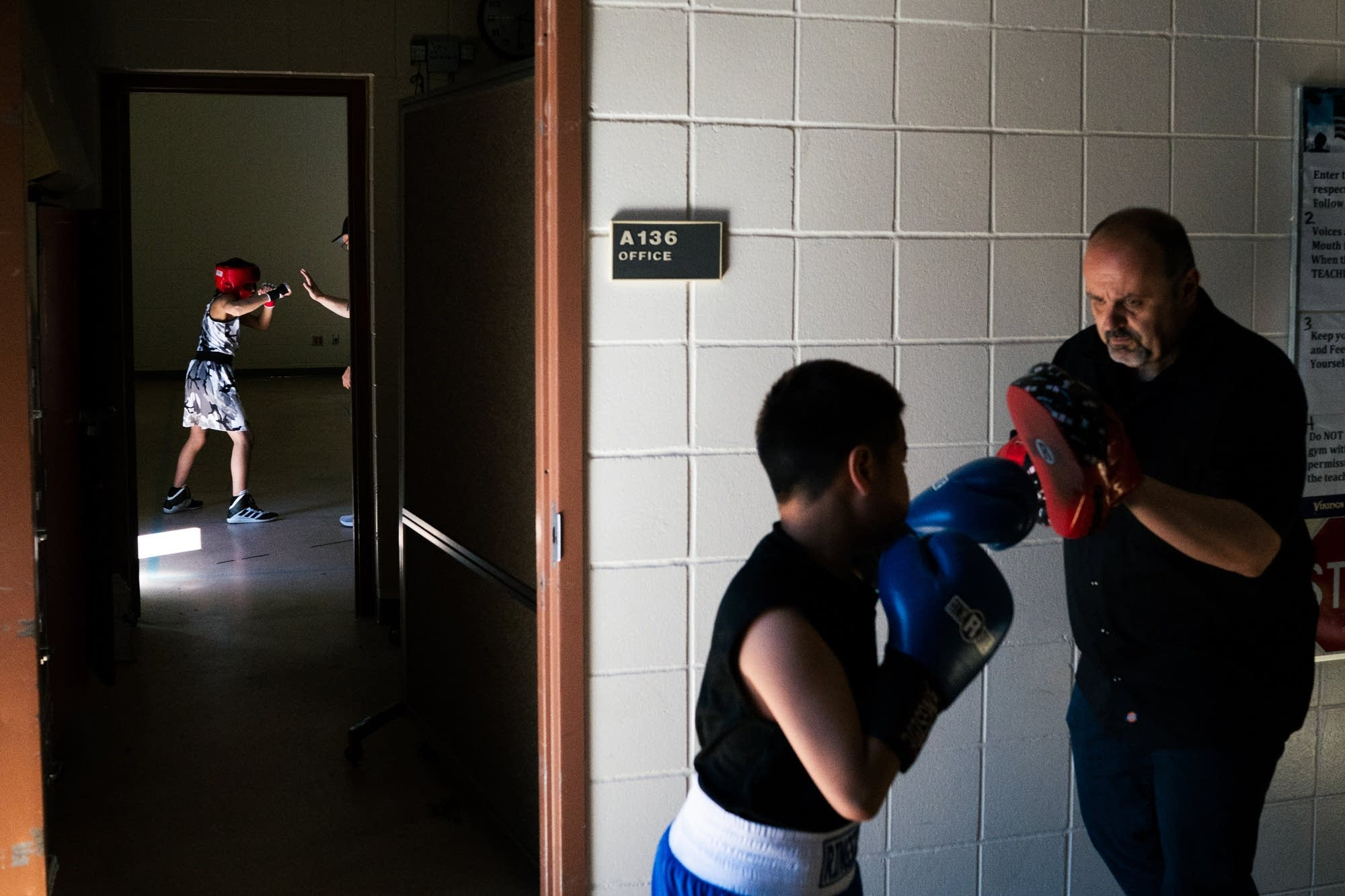 leven-year-old Alberto Luna of Leech Lake, left, drills with his coach.