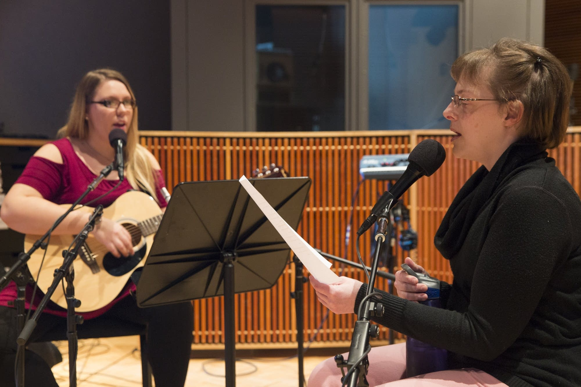 Mandy Blume, right, and her music therapist Haylee Brown perform a song