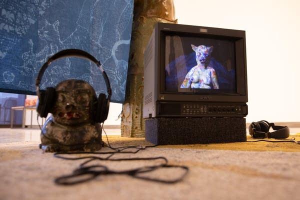 Headphones sit next to a TV.