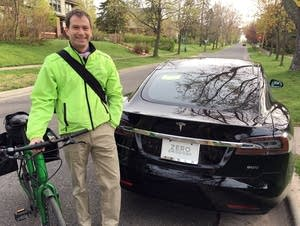 Duluth physician Andrew Nisbet shows off his new electric Tesla sedan.
