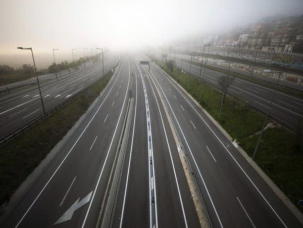 A highway leading to Barcelona is seen empty of cars